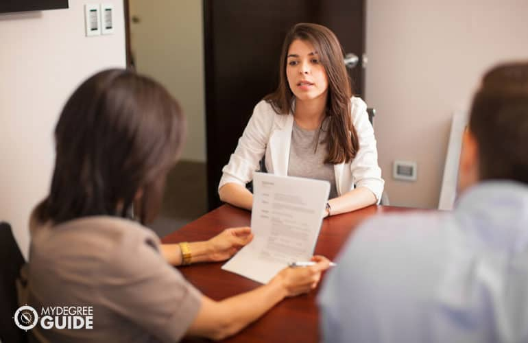 master's degree graduate having an interview in an office