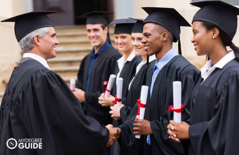 master's degree graduates receiving their diploma
