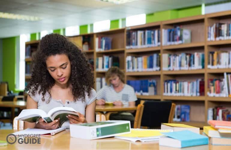 master's degree student studying in university library