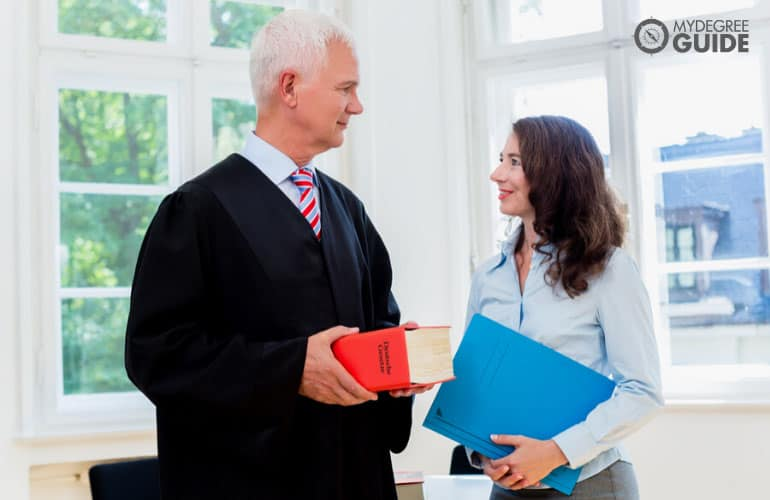 lawyer and paralegal in an office
