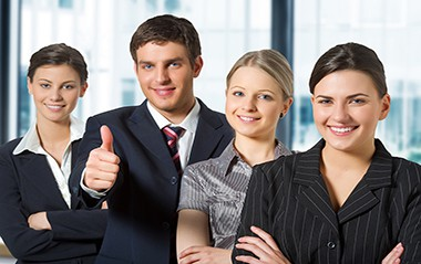 young guy thumbs up and three smiling lady with executive mba degree