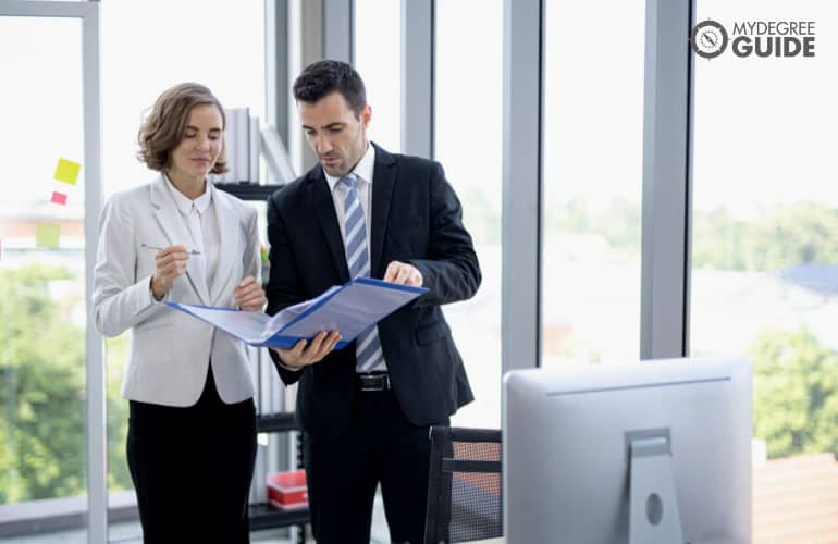 business professionals discussing near a computer