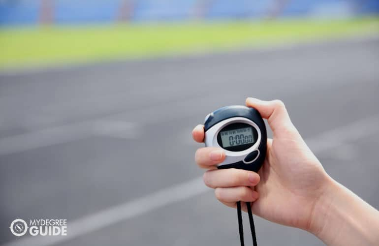 someone holding a stopwatch