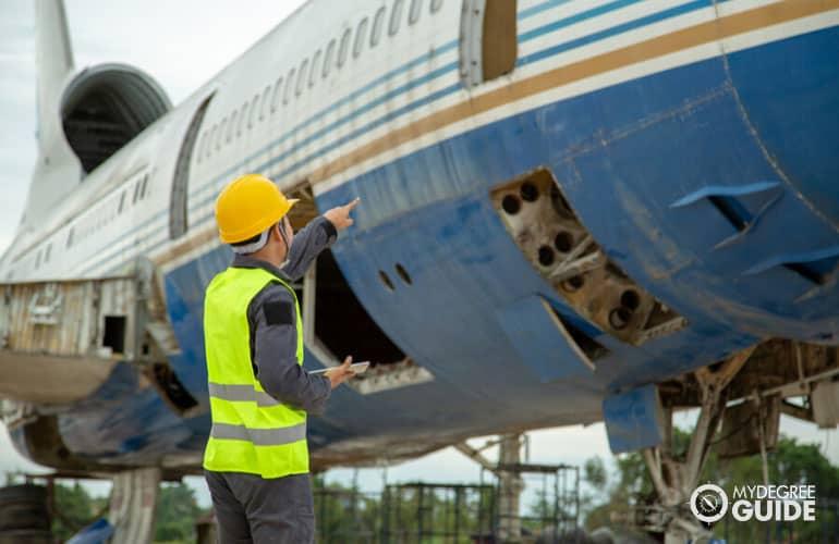 Aerospace Engineer checking on an airplane