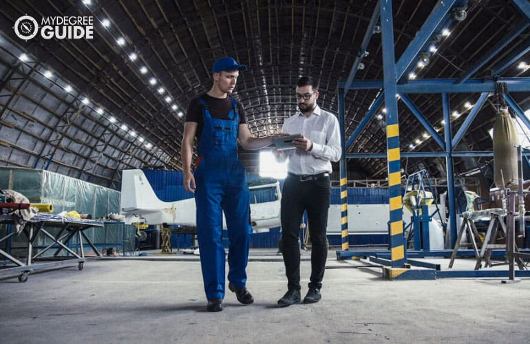 Aviation Manager having a discussion with an aircraft mechanic