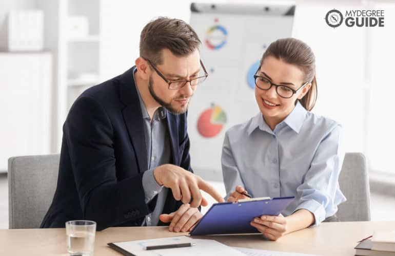 professionals consulting each other in an office