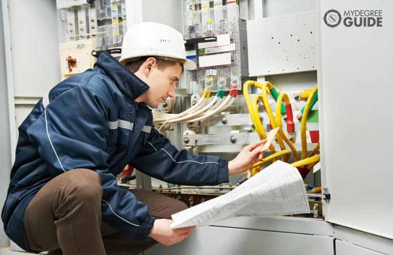 Electrical Engineer inspecting cable connection