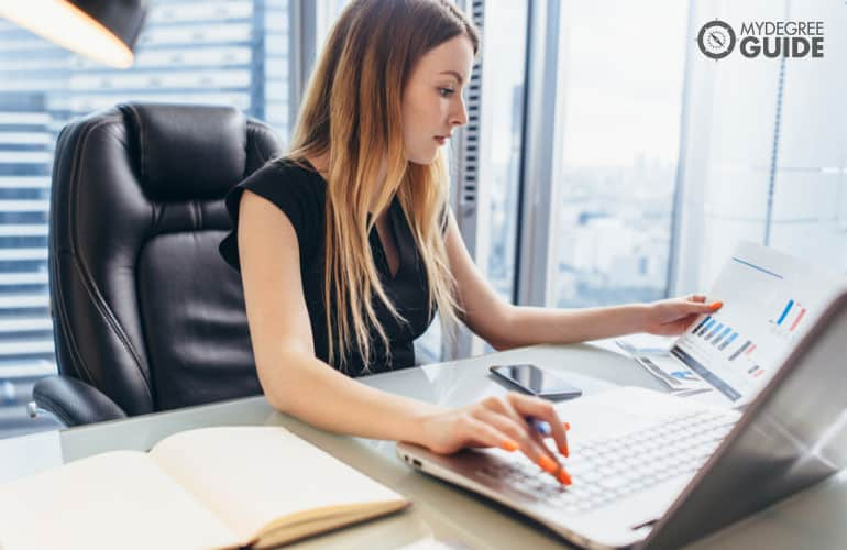 financial manager working on her computer