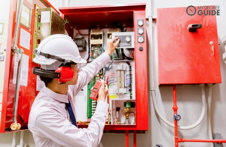 Fire Protection Engineer inspecting a fire control system