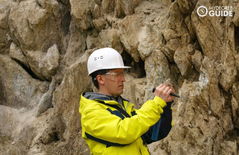 Geo scientist analyzing rock formations