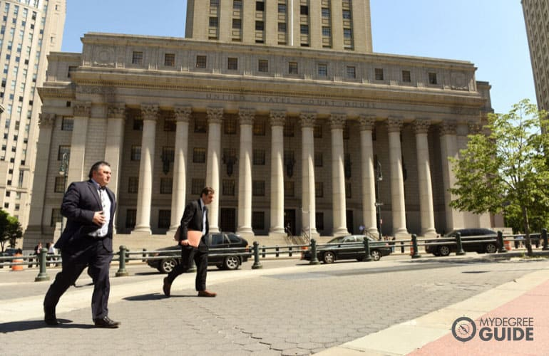 court clerks walking near a courthouse