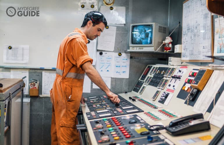 Marine Engineer working in engine control room