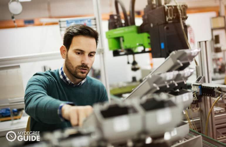 Mechanical Engineer working on a machine