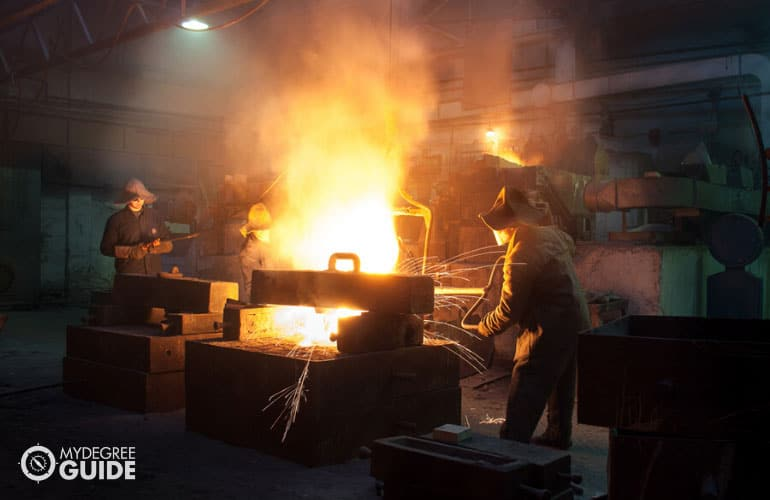 Metallurgic Engineer casting metals in a plant