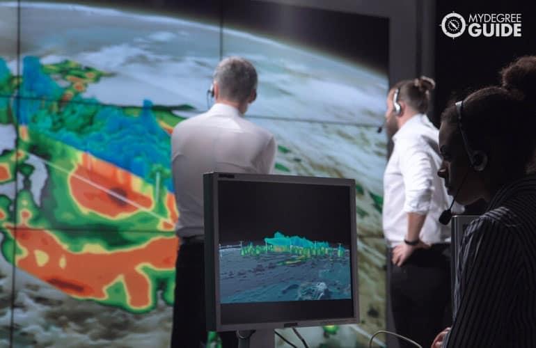 Meteorologists monitoring a hurricane