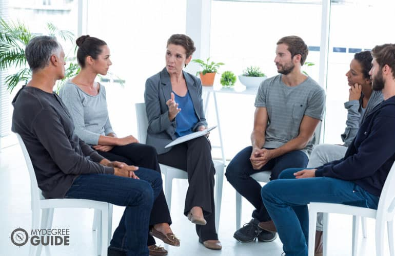 psychologist having a group therapy session
