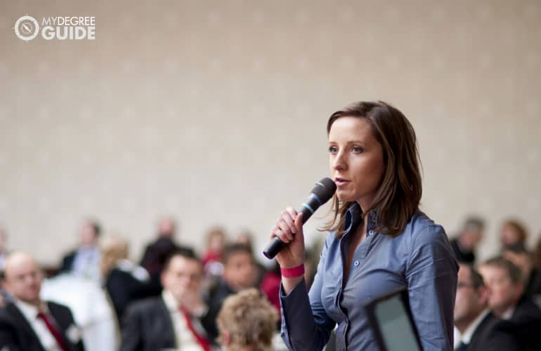 public administrator speaking during a conference