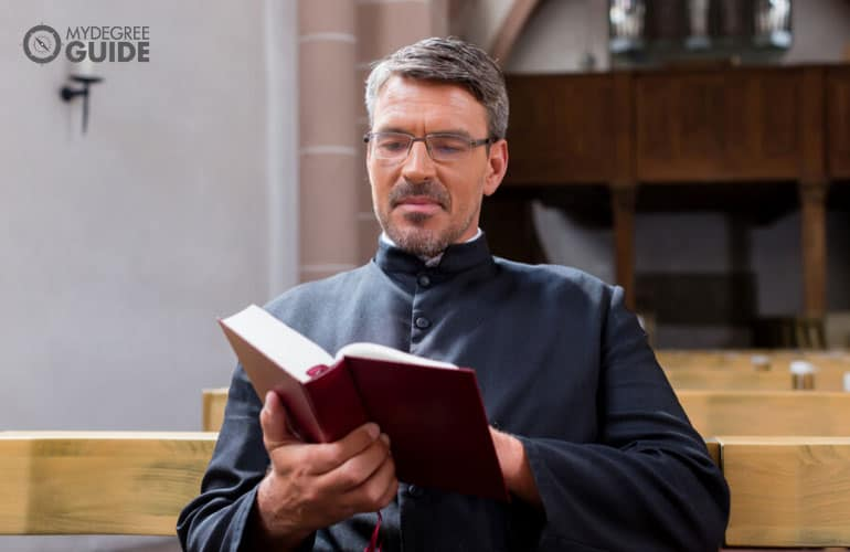 priest reading a bible