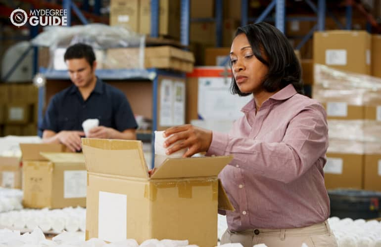 female manager checking goods at a warehouse