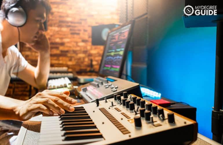 male composer making music in his studio