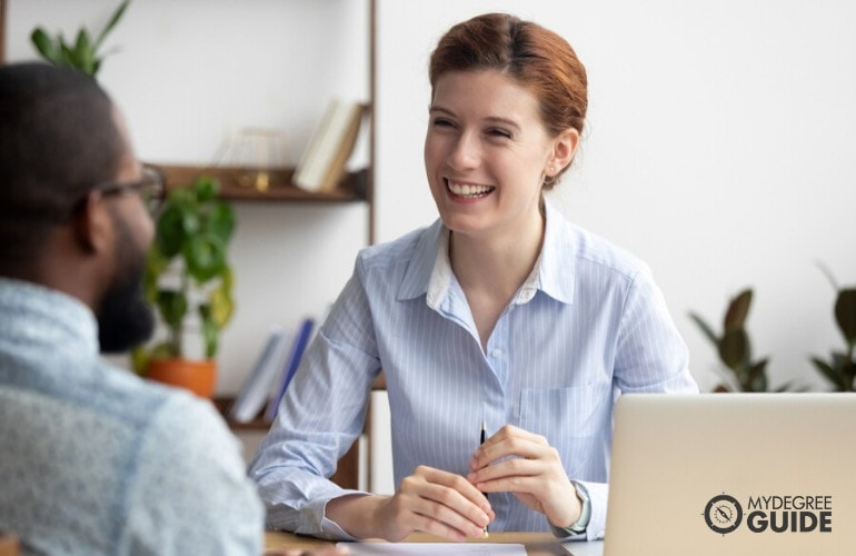 Recruiting Director talking to an employee in the office