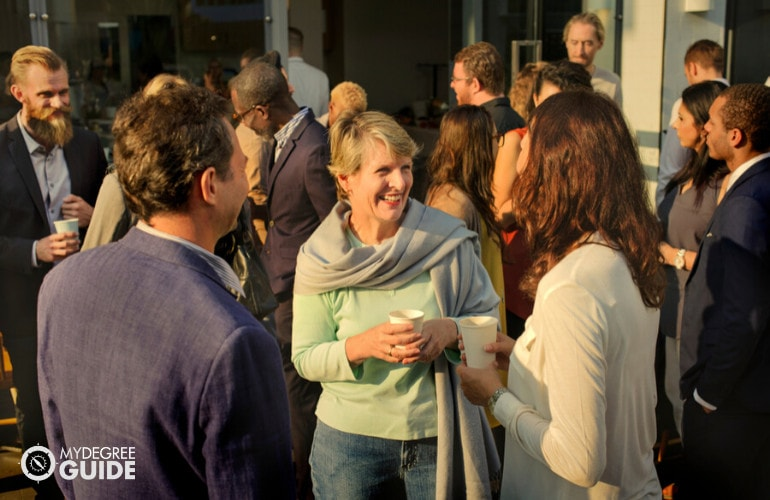 group of professionals mingling during a conference