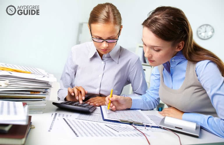 two female accountants working in the office