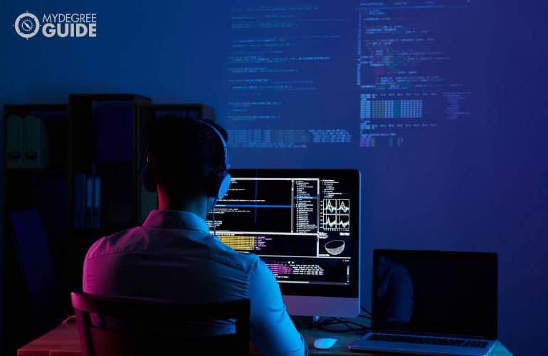 developer working at night in his home