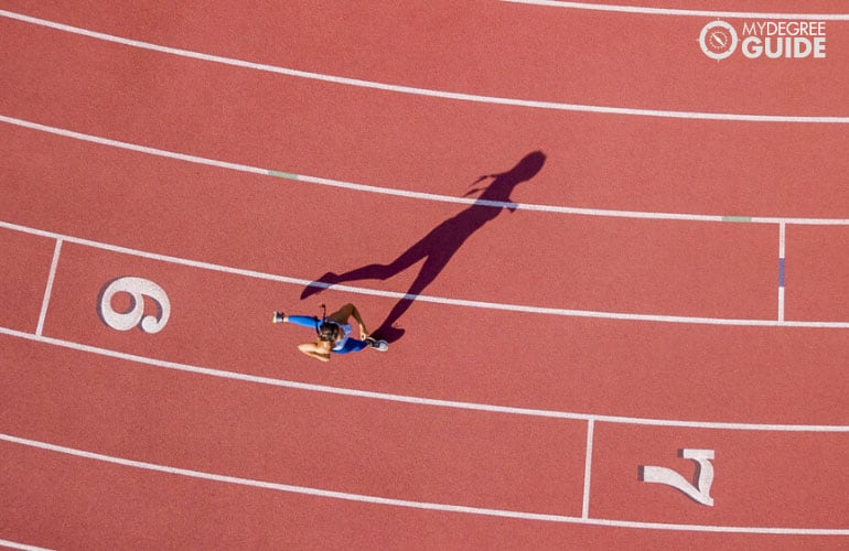 woman running in race track