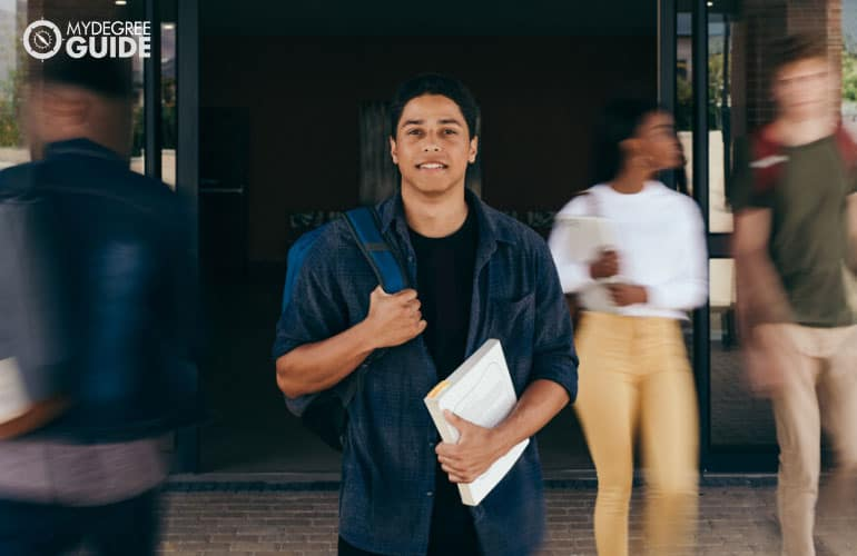 male student in a university with motion blur background