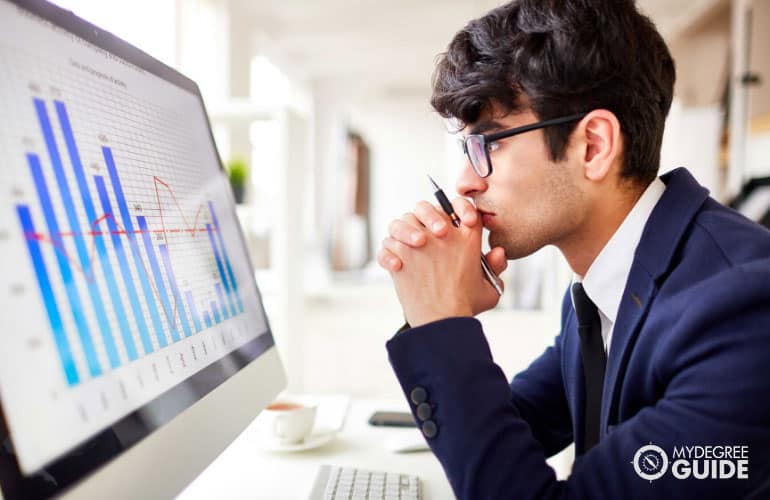 male office worker looking at his computer