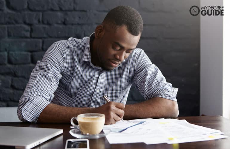 male student filling out financial paperwork