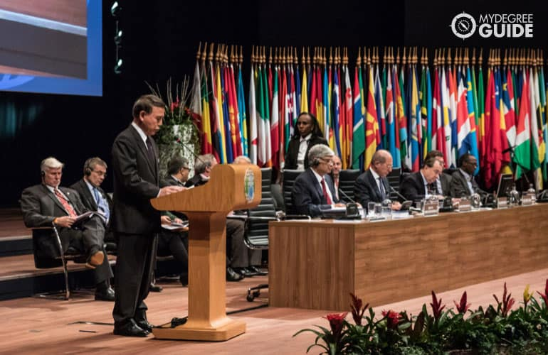 foreign diplomat giving a speech in an international conference