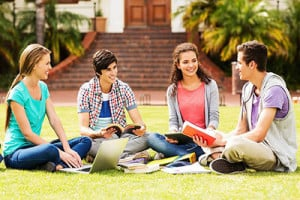 Students sitting on campus talking