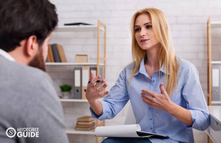 psychologist talking to a client in her office