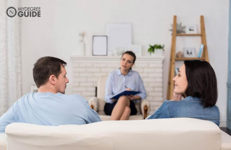 couple talking to a therapist during counseling session