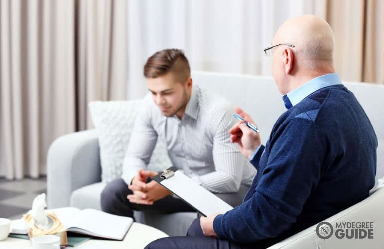 medical family therapist talking to a client with mental health illness