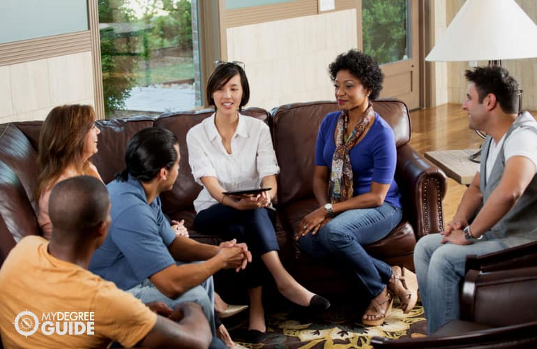 group of people sharing their stories during group counseling session