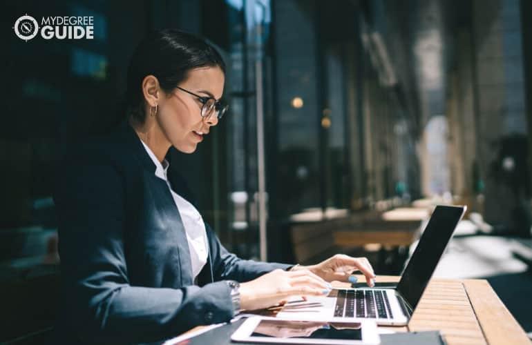 female economist working on her laptop