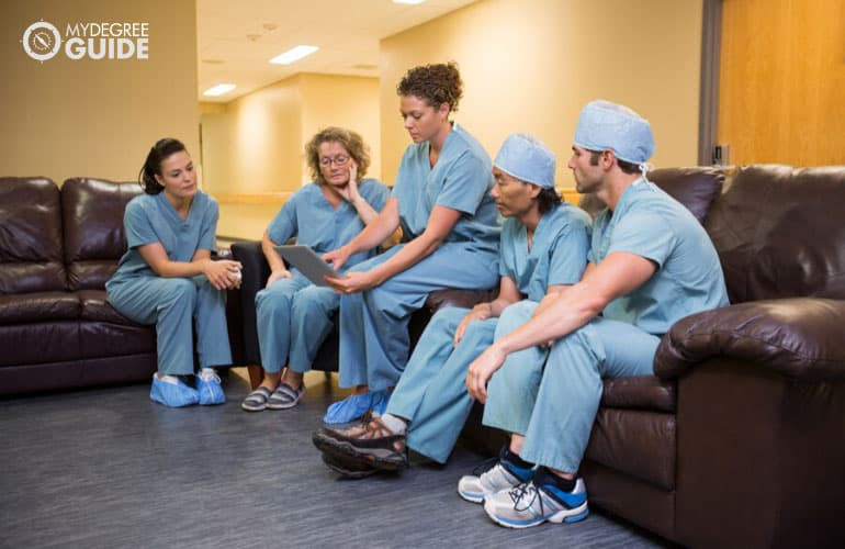 head nurse talking to fellow nurses in hospital
