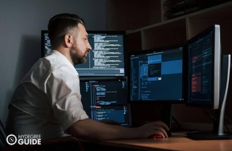 Computer programmer sitting at desk
