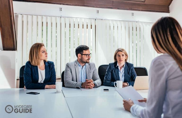 company's human resource persons interviewing a job applicant