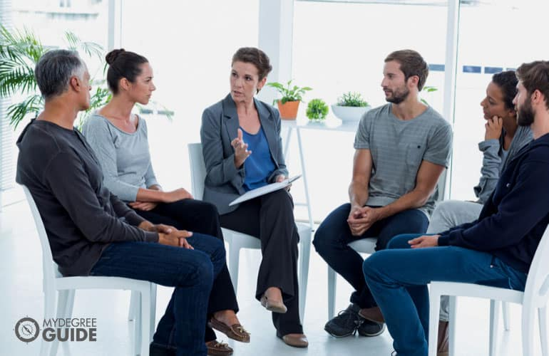 psychologist conducting a group therapy session