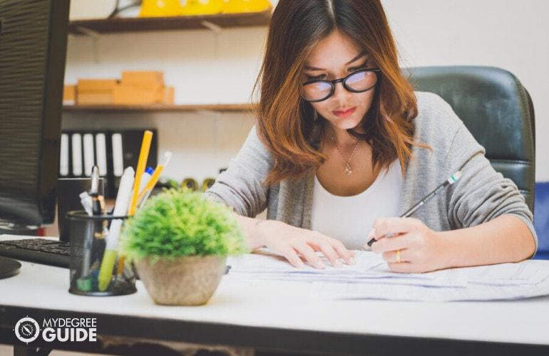 female financial advisor working on her office