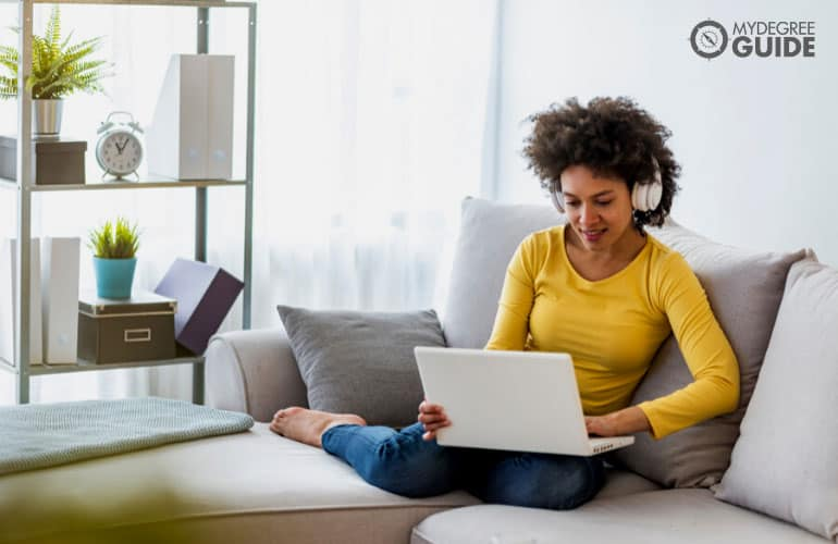 counseling degree student studying on her laptop comfortably