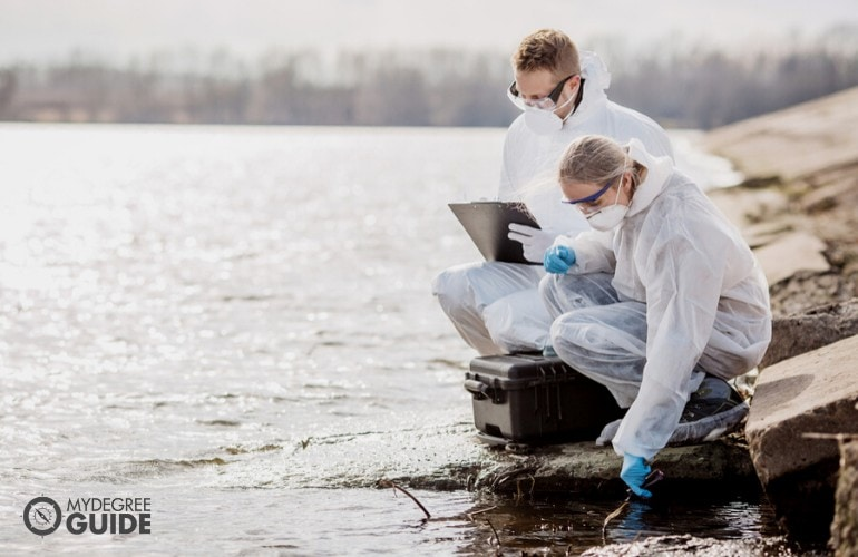 biologists working together on water analysis
