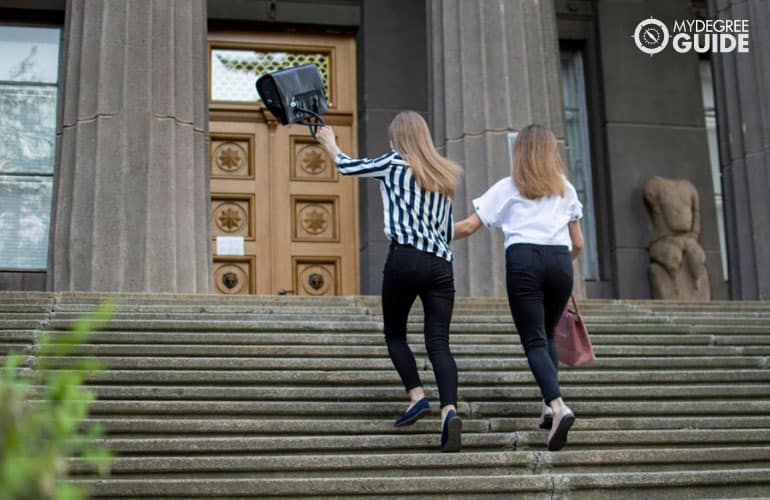 project management students entering a college building