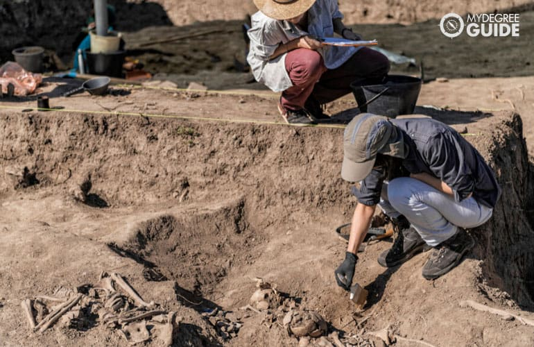 female archaeologists researching on ancient human bones