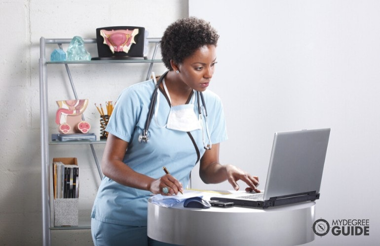 a nurse studying on her computer