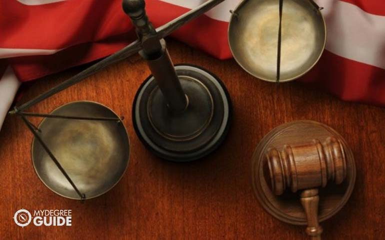 associate degree student with gavel and scale